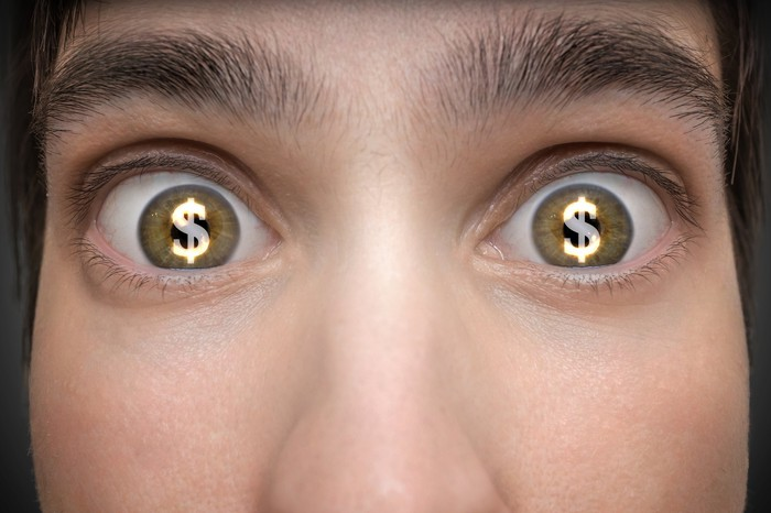 Dollar signs in eyes of young person