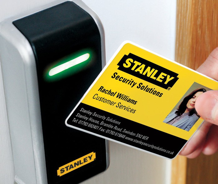 A security card with the Stanley logo on it being read by a Stanley card scanner.