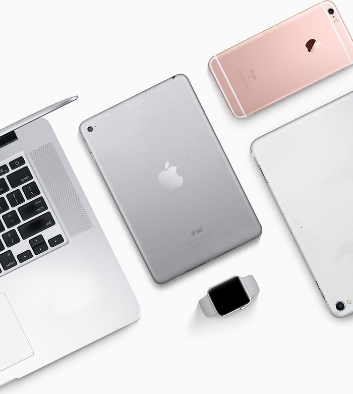 An assortment of Apple devices including the iPad, iPhone, Apple Watch, and Mac.