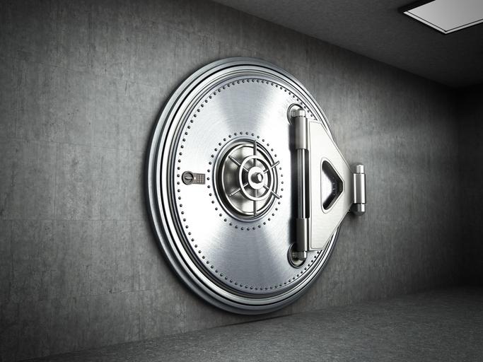 Round, secure steel bank vault door.