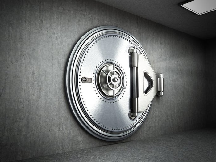 Round, secure steel bank vault door.