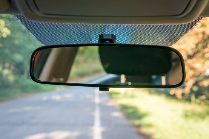 A car's rearview mirror.