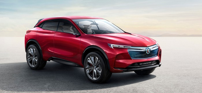 The Buick Enspire, a sleek red midsize crossover SUV.