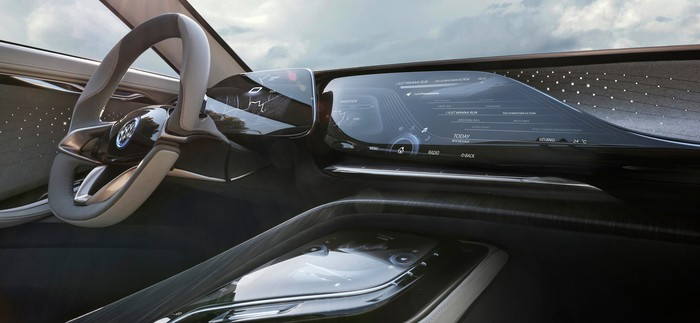 A view of the Buick Enspire concept's steering wheel and dashboard. The dash appears to be one single long touchscreen.