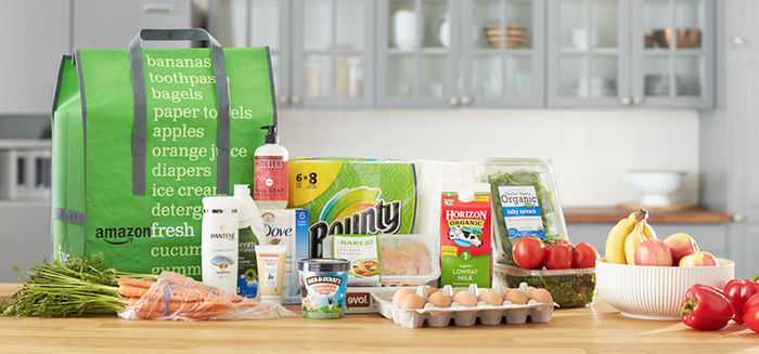 An AmazonFesh grocery order on a kitchen counter.