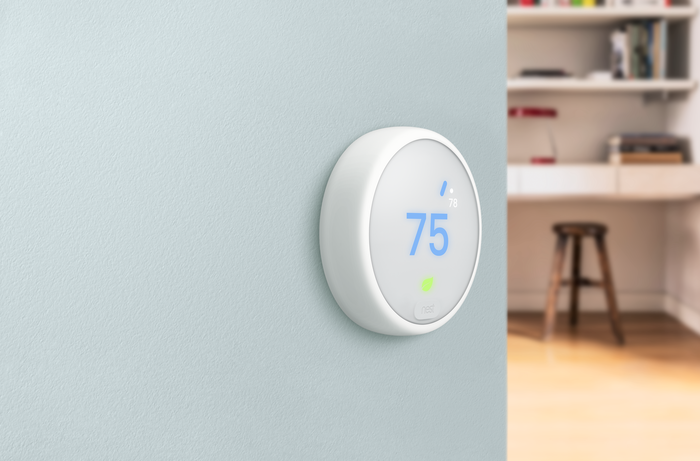 Nest smart thermostat on a wall