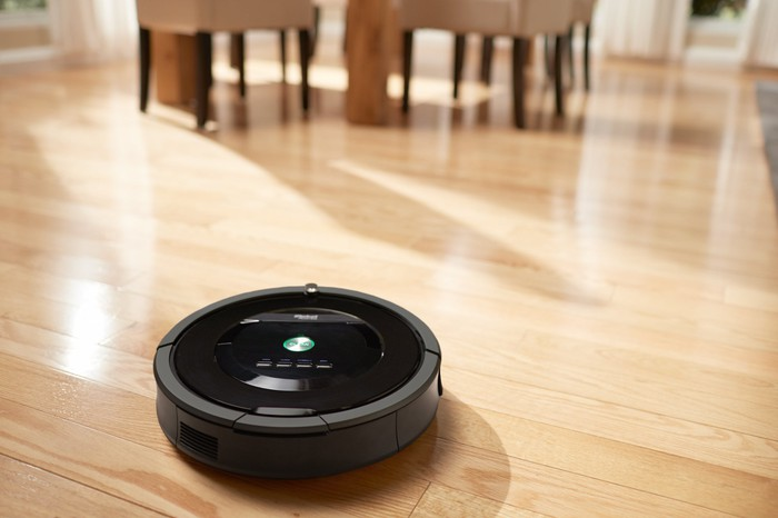 Roomba cleaning a hardwood floor