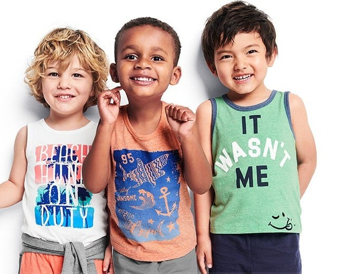 Three children wearing Osh Kosh B'Gosh closthing
