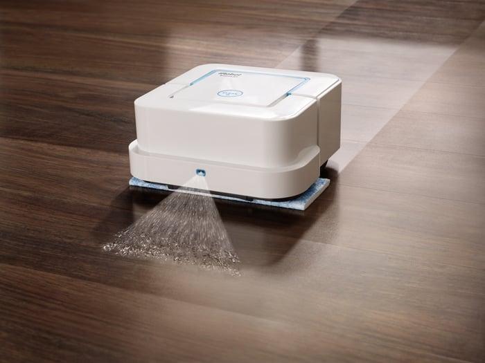 iRobot Braava mopping robot cleaning a wood floor