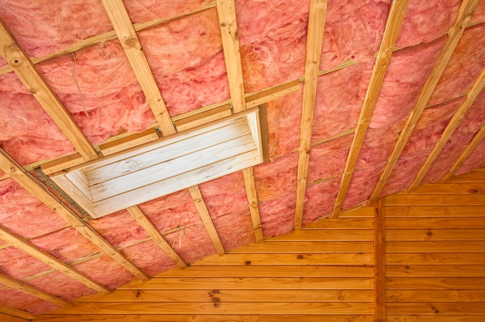Pink insulation on the inside of a roof.