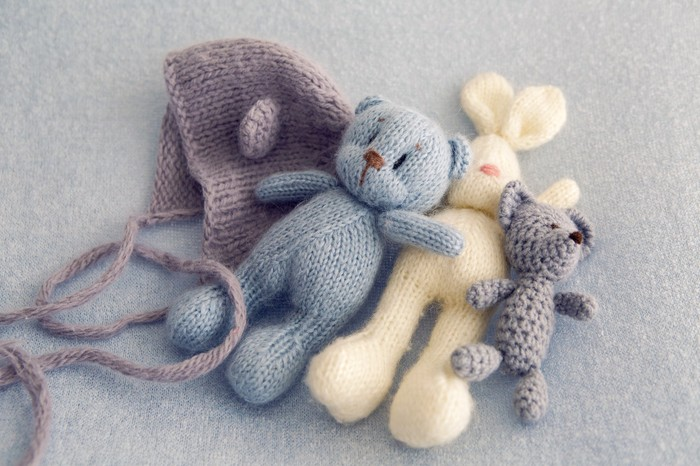 Hand-knitted stuffed animals and a hand-knitted hat.