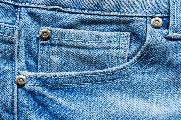 a closeup of a pocket on a pair of jeans.