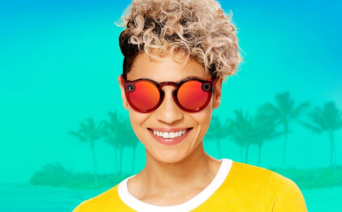 Person wearing Spectacles 2 in front of a stylized background