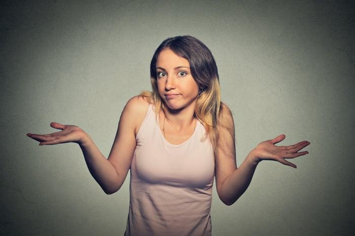 Young woman shrugging