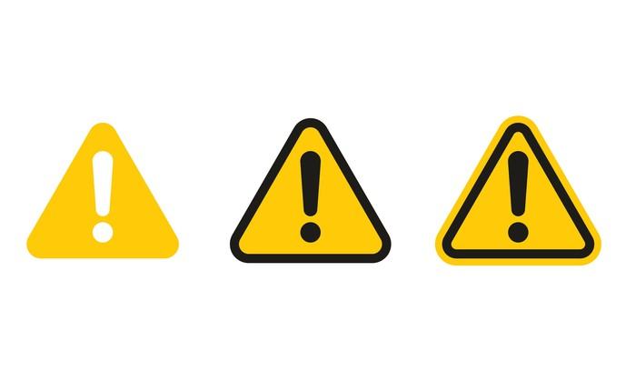 Three yellow triangles, one with a white exclamation point, and two with black exclamation points in them.