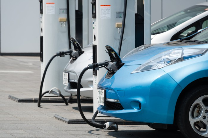 Electric vehicle plugged in at a charging station.