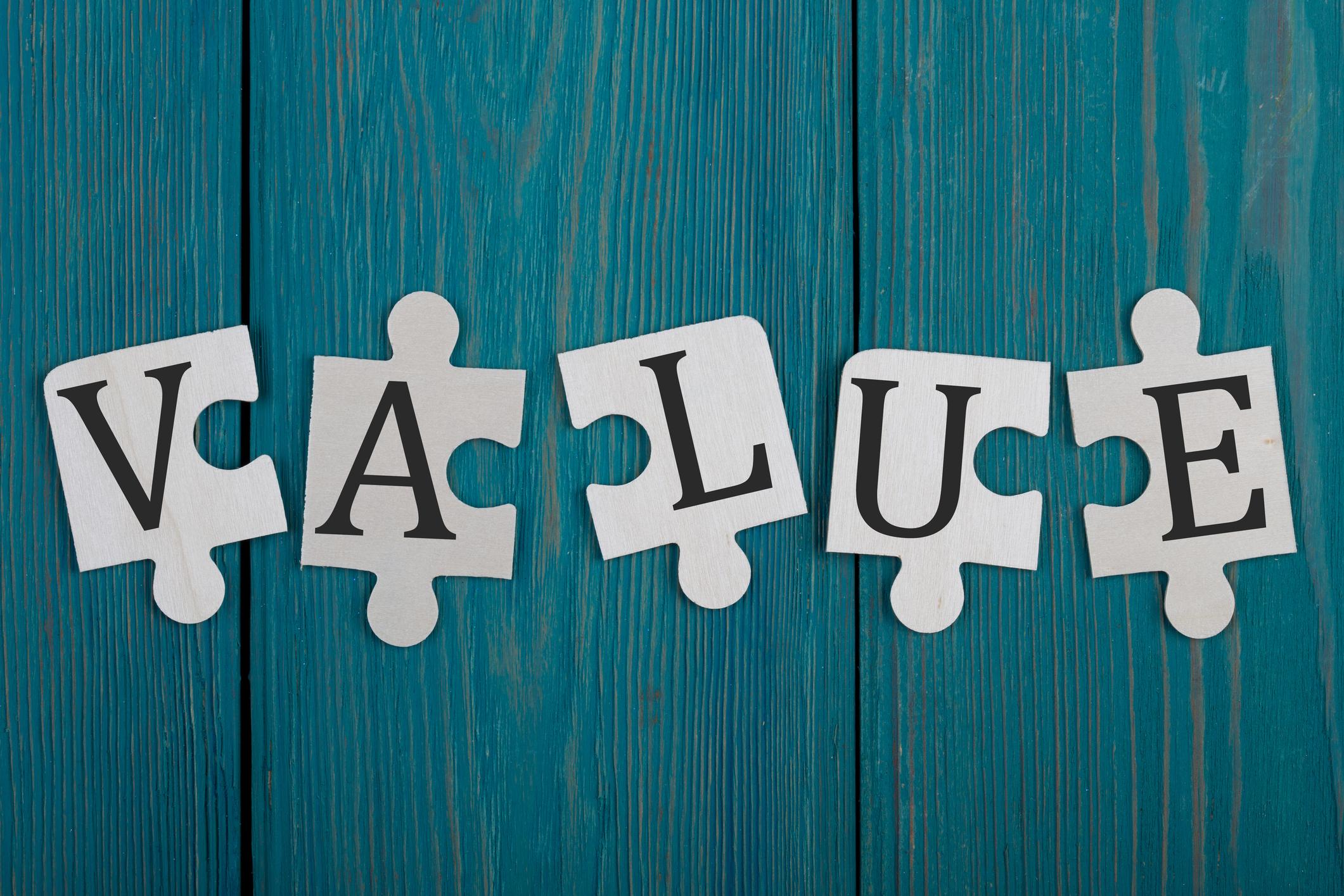 Puzzle pieces spelling Value.