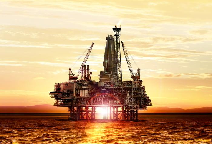offshore oil platform at sunrise.