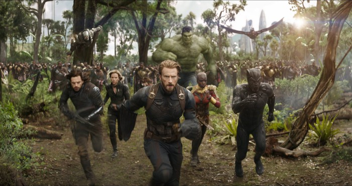 Characters from Avengers: Infinity War, led by Captain America run towards an unseen foe.