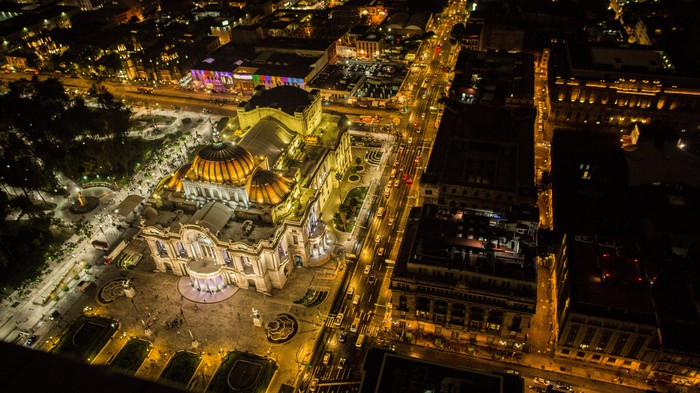 Overhead night image of the illuminated Palacio De Bella Artes, Mexico City