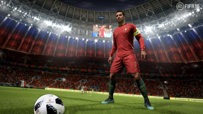 Screenshot of FIFA video game depicting a soccer player standing on the field of a stadium behind a soccer ball.