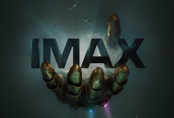 """Infinity Gauntlet Glove from """"Avengers: Infinity War"""" reaching for the IMAX logo."""