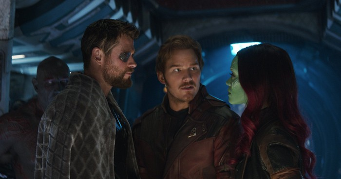 """In a still from """"Avengers: Infinity War,"""" Thor, Star-Lord, and Gamora stand talking"""