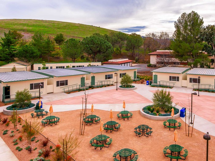 An ariel view of the courtyard of a school with modular buildings.