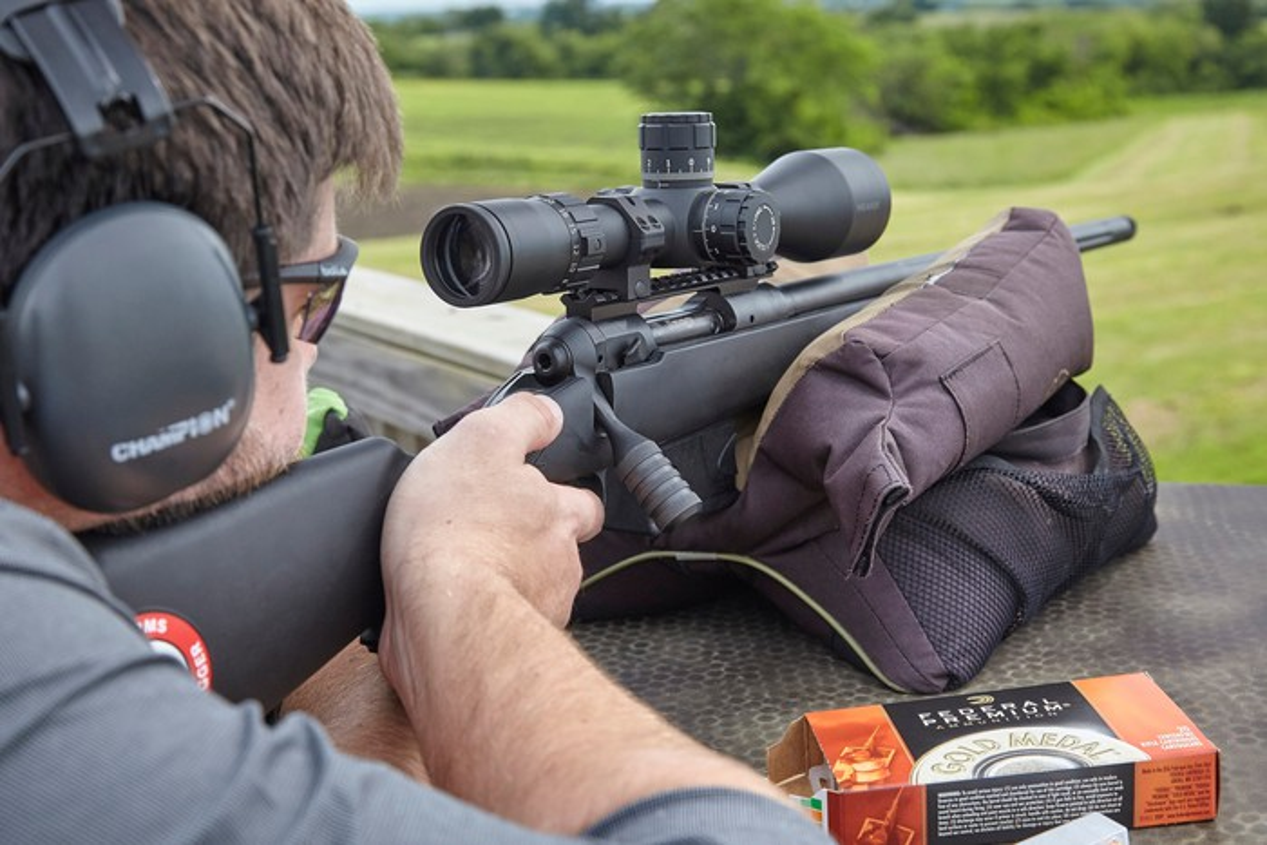 Man shooting a scoped rifle