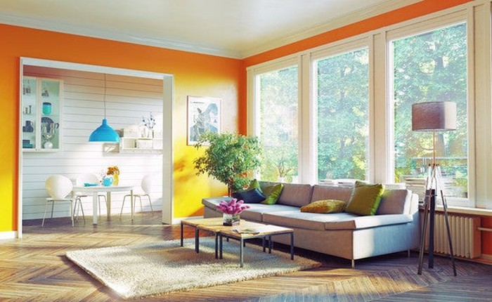 A living room with windows in the back.