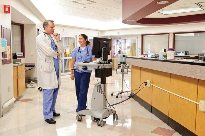 Medical staff in hallway of hospital.