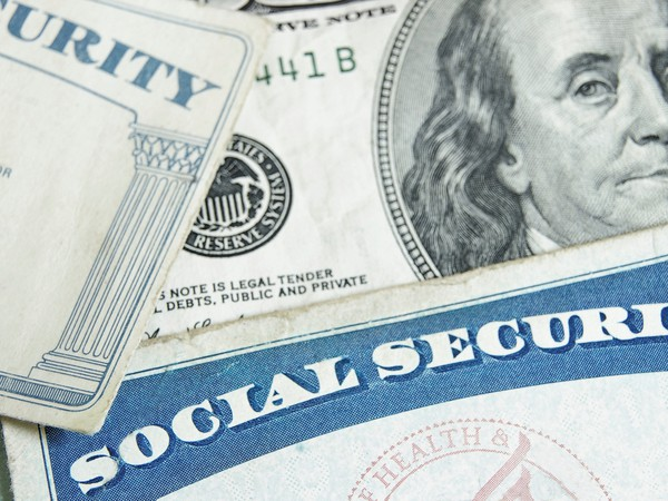 social security card with money hundred bill