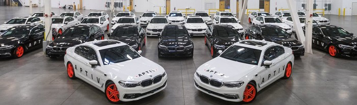 Fleet of parked Aptiv/Lyft partnered vehicles.