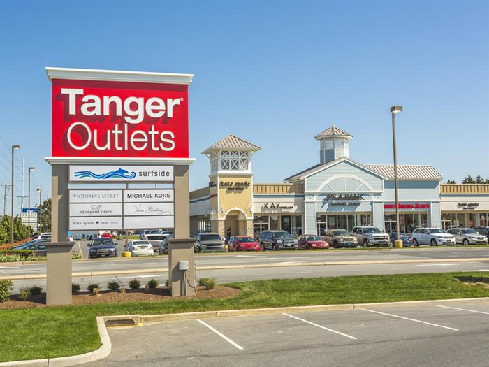 A Tanger Outlets Mall with sign in the foreground.