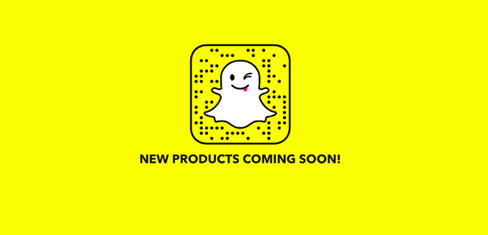 "The ghost in Snap's logo is seen against a yellow background with the words ""new products coming soon!"" underneath"