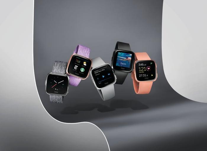 Five of Fitbit's Versa smartwatches.
