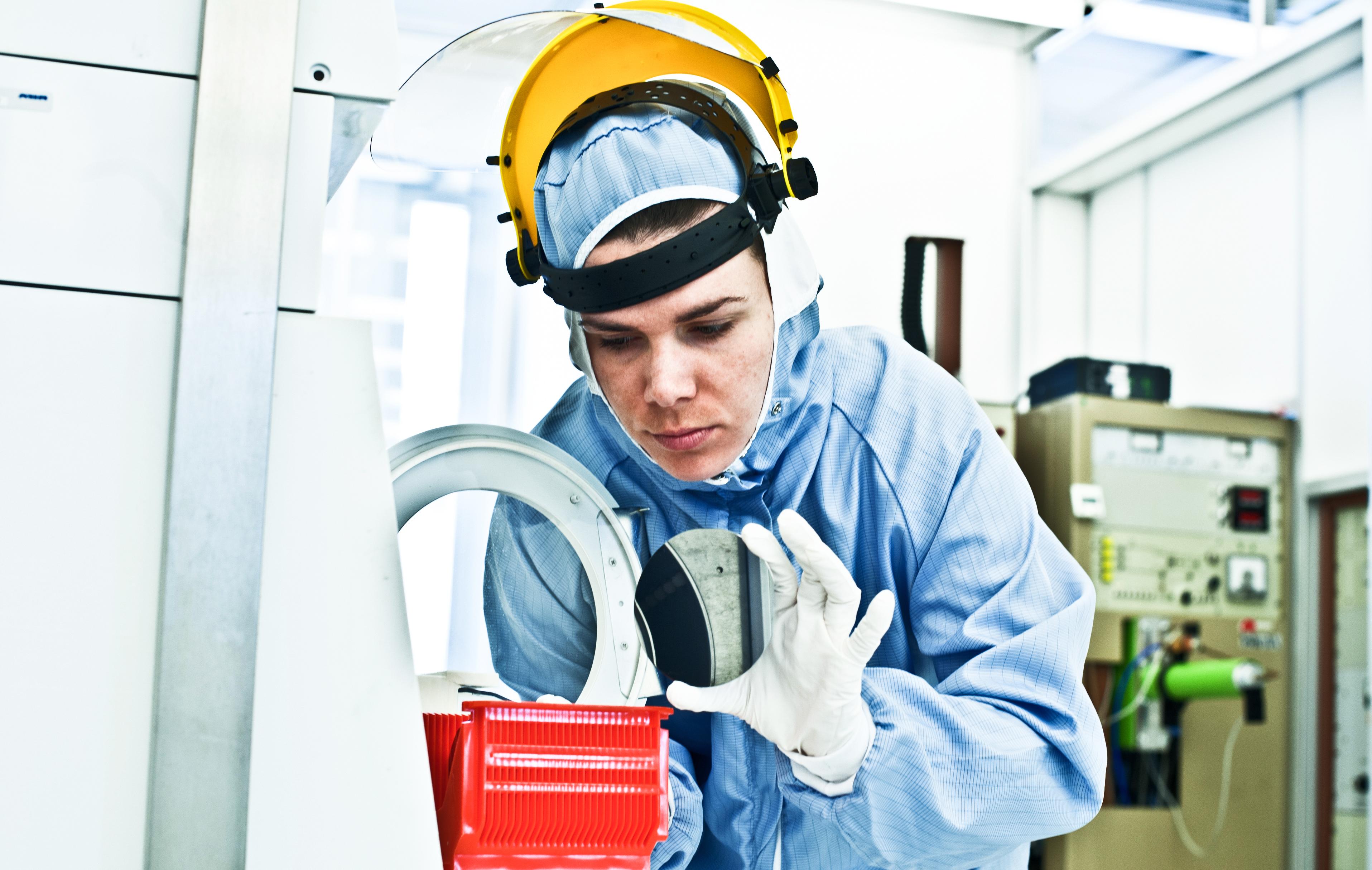 Worker handling semicondutor wafer