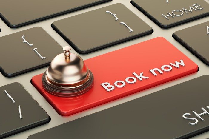 A keyboard with the Enter key replaced with a key that says Book now.