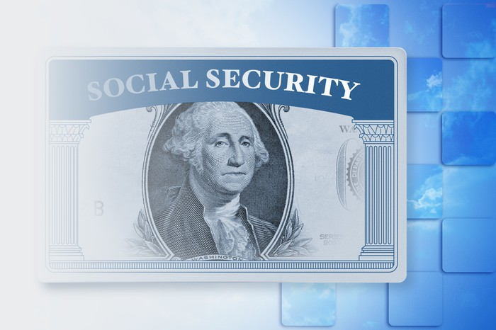 Social Security card with middle of a dollar bill superimposed on it.