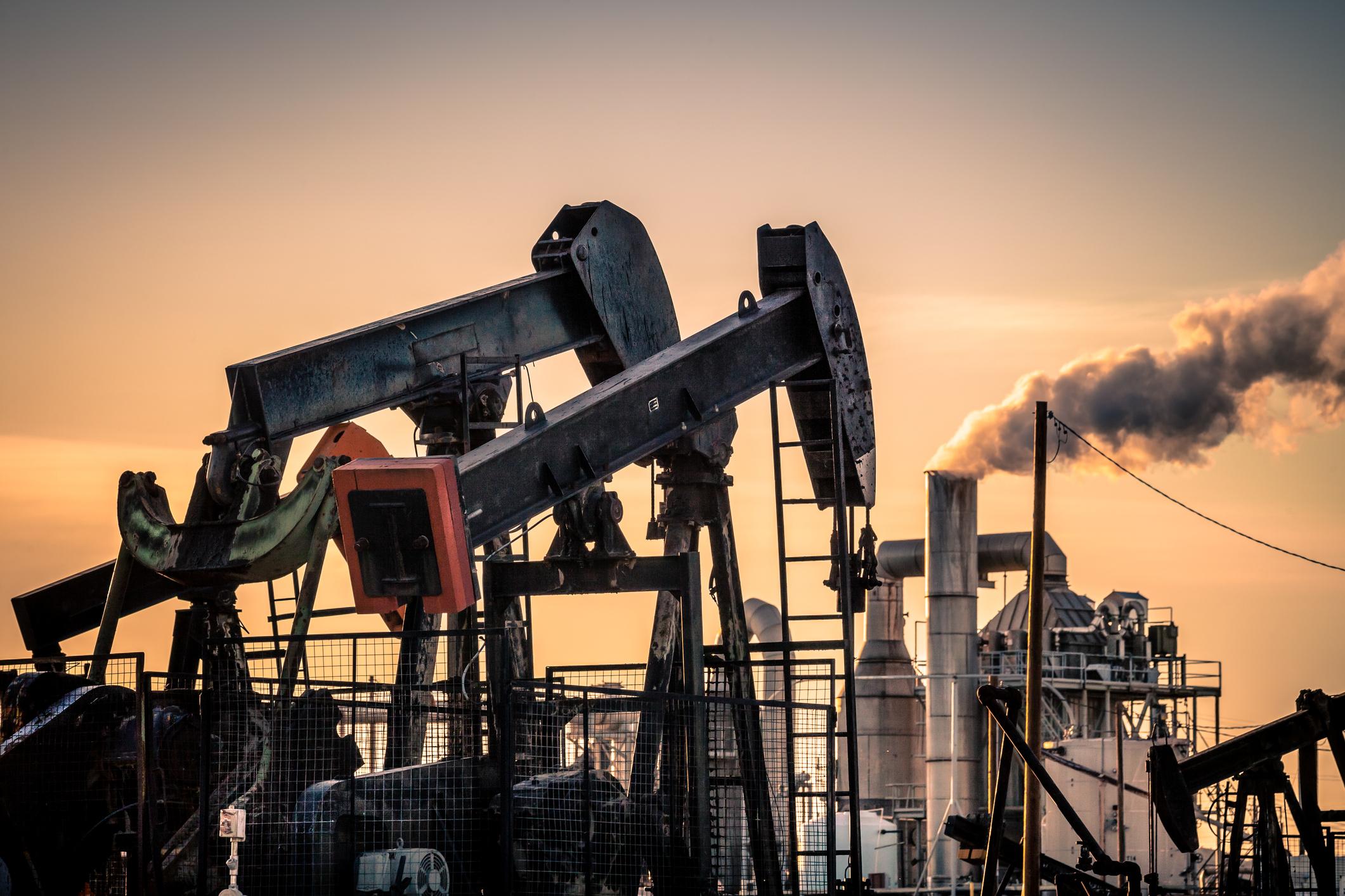 Oil pumps near an industrial complex in California.