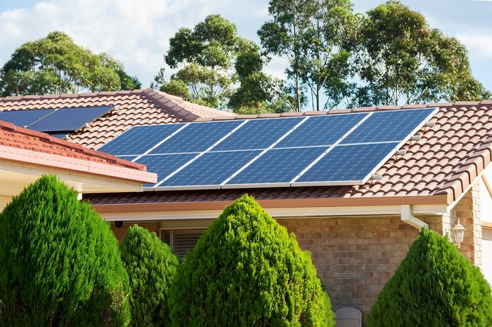 Home with rooftop solar installed.