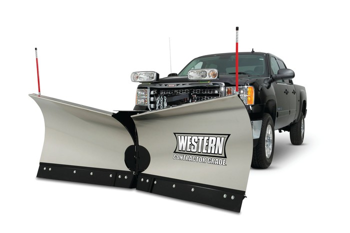 Black pickup truck pushing gray snowplow with Western brand name on it.
