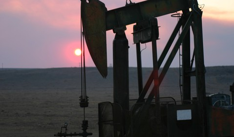 Oil pump with the evening sun going down.