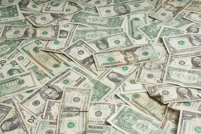 Image of a pile of U.S. bills.