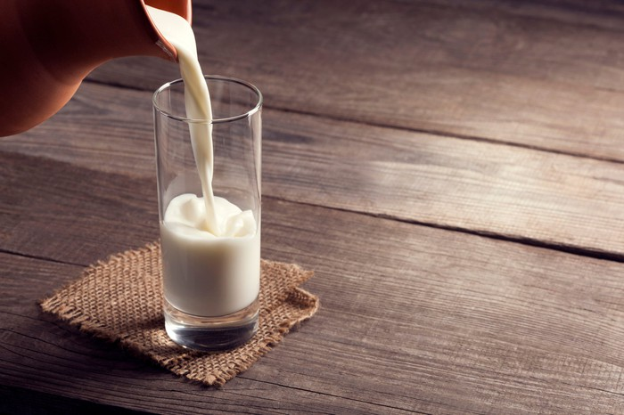Milk being poured into a glass.