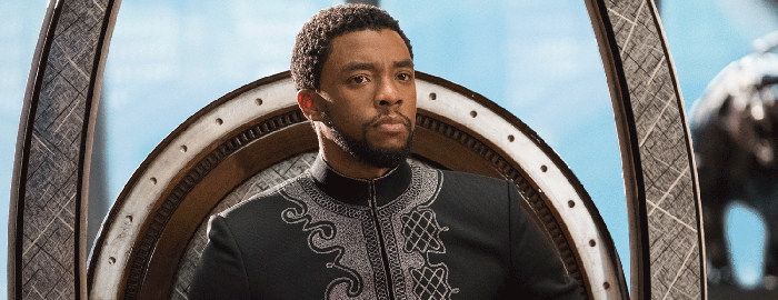 Black Panther's King T'Challa sitting on the Wakandan throne.