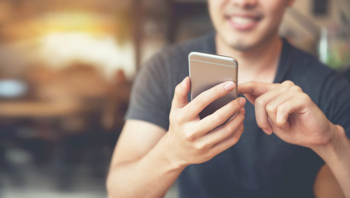 Man using cell phone.
