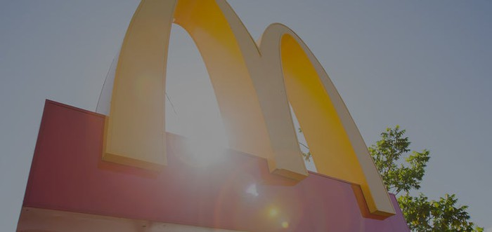Exterior golden arches signage with bokeh photographic effect.