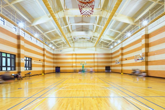 Brightly lit, contemporary indoor basketball court