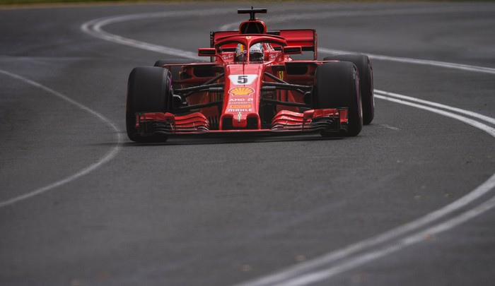 A red Ferrari Formula 1 racecar wearing the number 5 is shown on-track during the Australian Grand Prix on March 25, 2018.